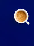 Coffee cup. Abstract coffee cup composition from the top with blue background Stock Photo