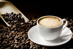 Coffee cup. A cup of cappuccino with coffee bean as background