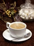 Coffee cup. And spoon on brown background and white sugar royalty free stock photo