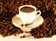 Coffee cup. Cup of coffee with coffee beans stock photography