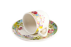 Coffee cup. Small white coffee cup with flowers around Royalty Free Stock Photography