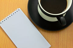 Coffee cup. And white notebook Stock Photography