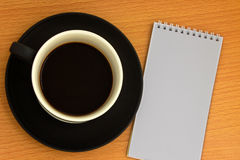 Coffee cup. And white notebook Royalty Free Stock Photo