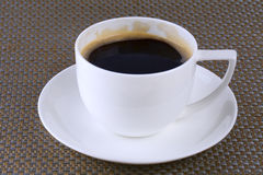Coffee Cup. White cup with fresh brewed coffee. Close up shot, shallow focus Royalty Free Stock Photography