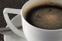 Coffee Cup. White cup with fresh brewed coffee. Close up shot, shallow focus Royalty Free Stock Photos