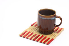 Coffee cup 231. Brown coffee cup on a small placemat Royalty Free Stock Images