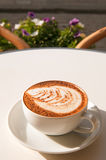 Coffee cup. On the white wooden table stock image