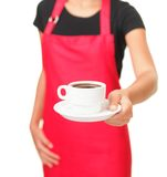 Coffee cup. Waitress serving coffee cup. Close up of hand showing coffee isolated on white background Royalty Free Stock Photo