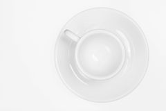 Coffee cup. White modern coffee cup with saucer, isolated background Royalty Free Stock Photos