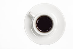 Coffee cup. Black coffee poured into white modern cup with saucer, isolated background Royalty Free Stock Photo