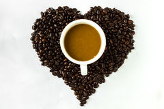 Coffee cup. Coffee heart cup and coffee  beans Royalty Free Stock Photos