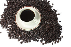 Coffee cup. With brown coffee beans texture Stock Photos