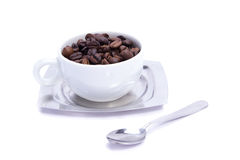 Coffee cup. Coffee beans poured into white coffee cup. Isolated on white Royalty Free Stock Photography