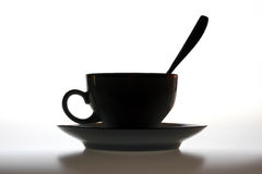 Coffee cup. Silhouette of a coffee cup on a white background Royalty Free Stock Image