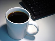 Coffee Cup. By keyboard Royalty Free Stock Image