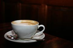 Coffee Cup. A cup of coffee, saucer and spoon Stock Photography