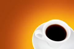 Coffee cup. White coffee cup over orange background stock images