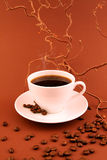 COFFEE CUP. With coffee-beans on toning brown background Royalty Free Stock Images