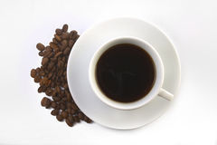 Coffee Cup. With coffee beans Royalty Free Stock Images