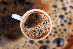 Coffee cup. On coffee background with clipping path Stock Images