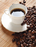 Coffee cup. White coffee cup and roasted brown coffee beans Stock Photos
