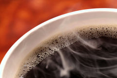 Coffee Cup. Coffee-Cup, orange background, Macro, copy space royalty free stock image