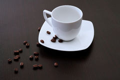 Coffee Cup. With coffee beans Stock Photography