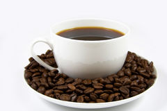 Coffee cup. White coffee cup with coffee and beans on the saucer Stock Image