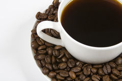 Coffee cup. White coffee cup with coffee and beans on the saucer Stock Photos