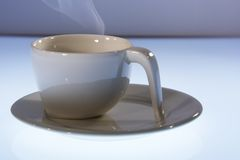 Coffee cup. A single coffee cup in foreground Stock Photography