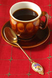 Coffee in cup. And spoon on red linen Royalty Free Stock Image