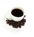 Coffee cup. White coffee cup with coffee beans Stock Image