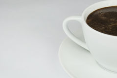 Coffee cup. Empty coffee cup on white table royalty free stock photography