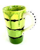 Coffee Cup. Green coffee cup with poka-dots on the handle isolated on a white background Royalty Free Stock Image