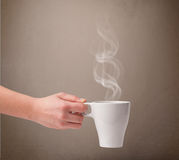 Coffee cup with abstract white steam Stock Images