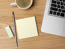 Coffee cup and adhesive note Stock Image
