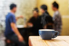 Coffee cup against Adult meeting or discus stock photos