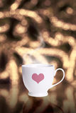 Coffee cup against bokeh background Royalty Free Stock Photos