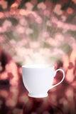 Coffee cup against bokeh background Stock Photography