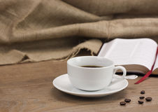 Coffee cup against a rustic background Stock Photos