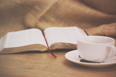 Coffee cup against a rustic background Royalty Free Stock Image