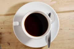 Coffee cup against wood table Royalty Free Stock Image
