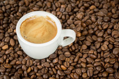 Coffee. Cup of coffee along with coffee beans royalty free stock images