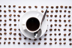 Coffee Cup And Lines Of Grains Royalty Free Stock Photos