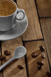Coffee Cup And Spoon On Wooden Table Stock Photo