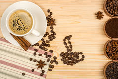 Coffee cup, anise stars, cinnamon sticks Royalty Free Stock Images