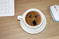 Coffee cup with astonished expression in  in cream coffee Royalty Free Stock Images