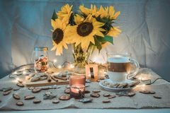 Coffee. A cup of coffee in autumn decorations with sunflowers stock photo