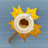 Coffee cup on the autumn fall leaves and wooden blue old table background.. Coffee cup on the autumn fall leaves and wooden blue old table background. Vector Stock Images