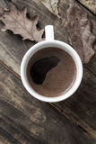 Coffee cup on the autumn fall leaves Royalty Free Stock Photos